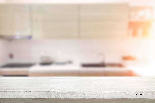 Wood desk space and blurred of kitchen background. – Foto