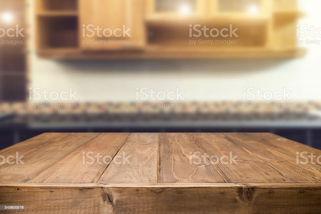 Wood desk space and blurred of kitchen background. - foto de acervo