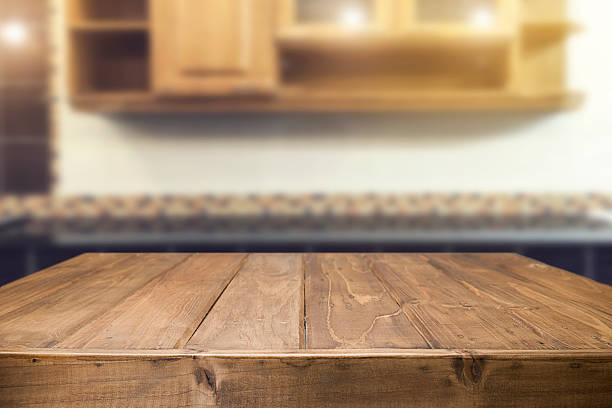 wood desk space and blurred of kitchen background. - surface level stock photos and pictures