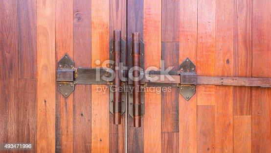 istock Wood door and iron door bolts. 493471996