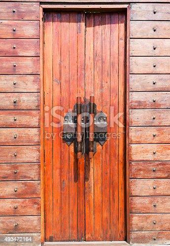 istock Wood door and iron door bolts. 493472164