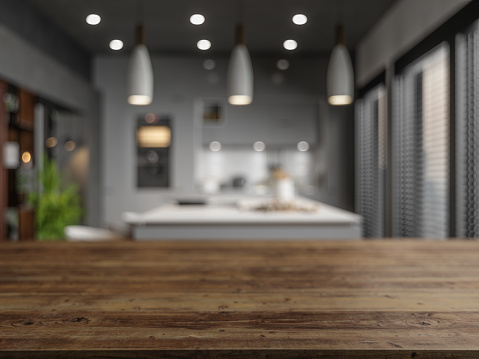 593305530 istock photo Wood Empty Surface And Kitchen as Background In The Evening 1205485088