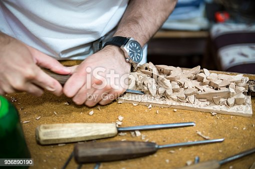 istock wood engraver at work for woodcut 936890190