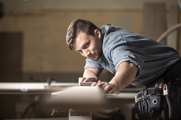 Wood expert checking board's quality stock photo