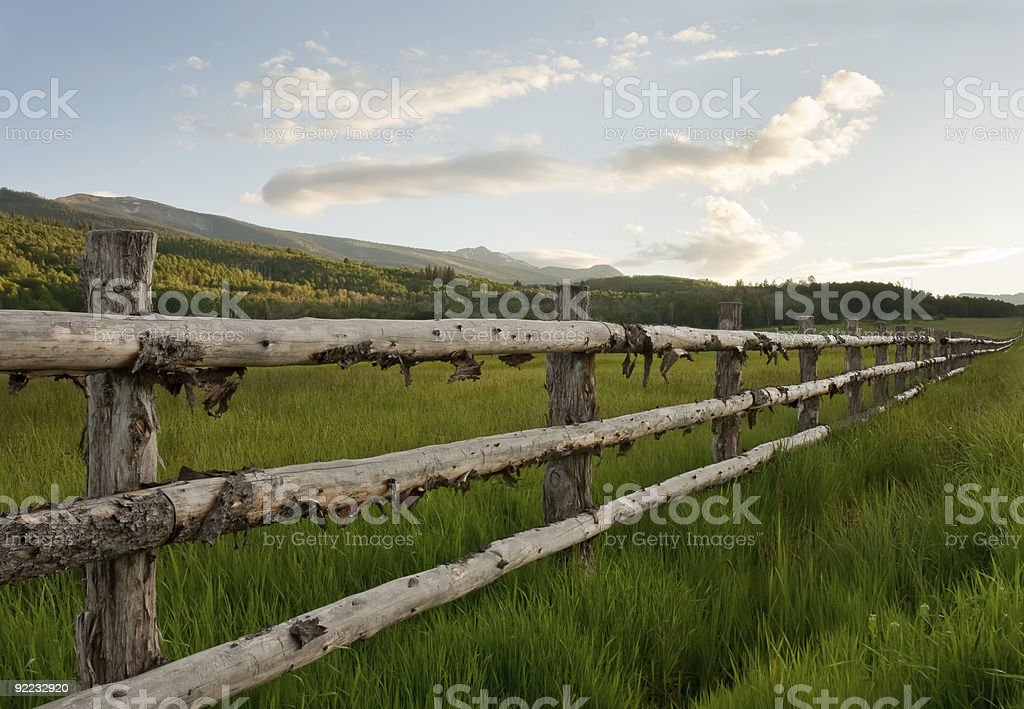 Wood fence at sunset in the Rocky Mountains stock photo