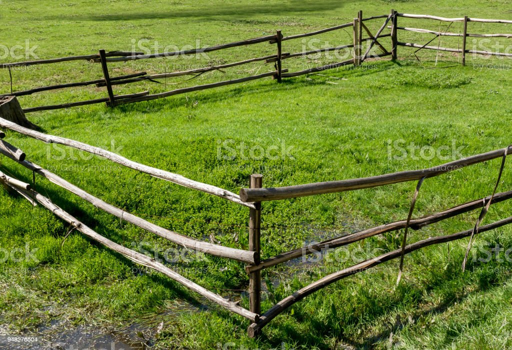 Wood fence on meadow at springtime in Turkey stock photo
