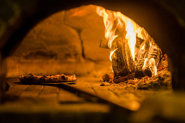 wood fire pizza cooking stock photo