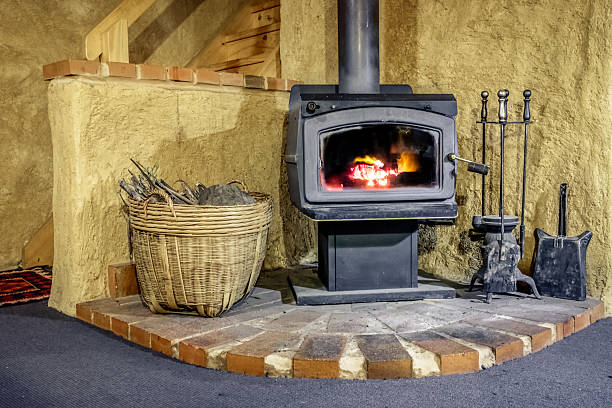 Wood Fired Stove in Mudbrick Cottage stock photo