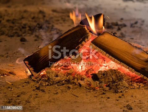 Wood fire and embers used for smoking food or home made bakery oven