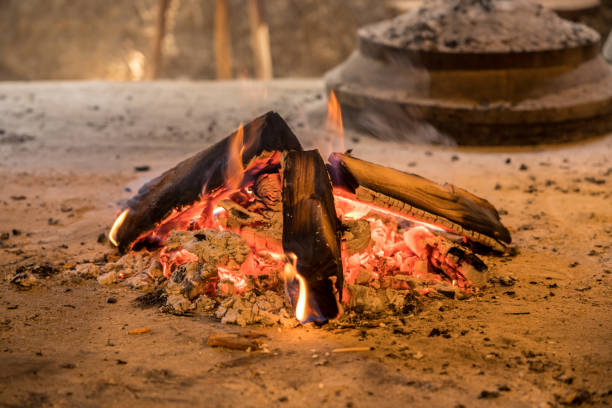 Wood firewood ablaze in rural cabin Wood fire and embers used for smoking food or home made bakery oven ablaze stock pictures, royalty-free photos & images