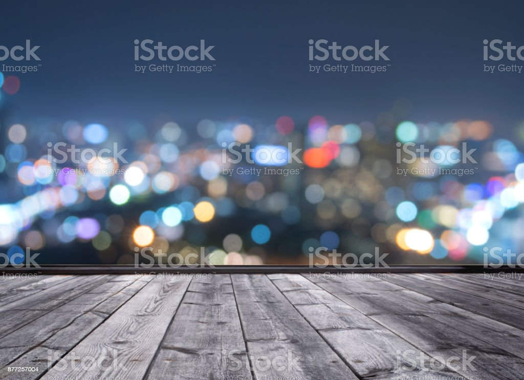 wood floor and blurred city light background stock photo