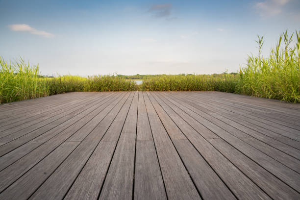 wood floor at lake side stock photo