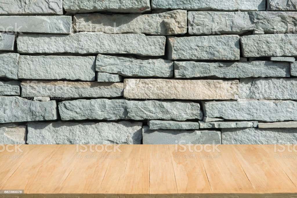 Wood floor with background of grunge white brick wall royalty-free stock photo