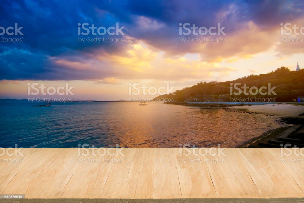 Wood floor with background of sea view at sunset royalty-free stock photo