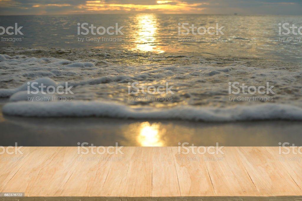 Wood floor with background of sea view at sunset zbiór zdjęć royalty-free