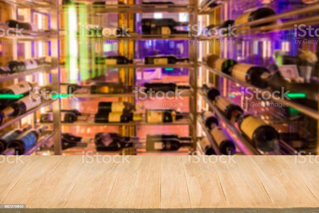 Wood floor with blur of alcohol bar background foto stock royalty-free