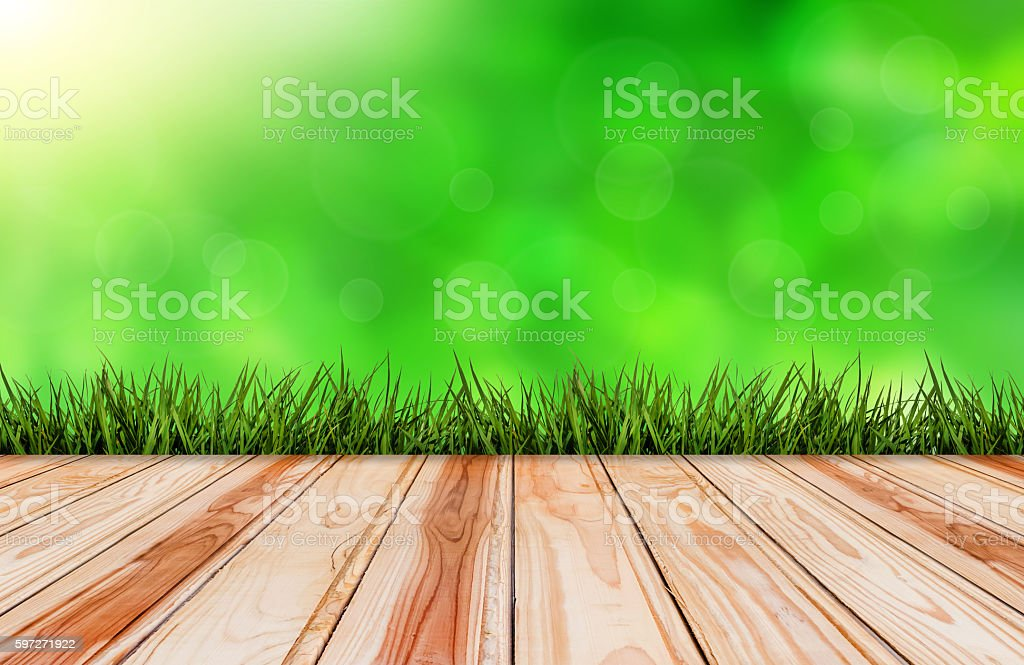 wood floor with grass and green nature background Lizenzfreies stock-foto