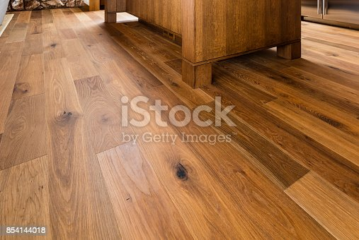 Wood flooring in home close-up with table
