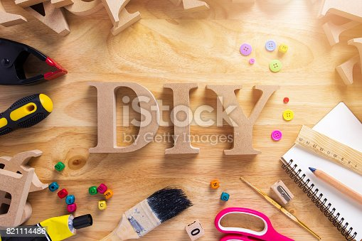 istock DIY Wood Font Style On a Wooden Workbench Top View.Do it Yourself concept 821114486