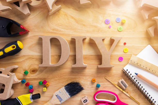 diy wood font style on a wooden workbench top view.do it yourself concept - art and craft stock pictures, royalty-free photos & images