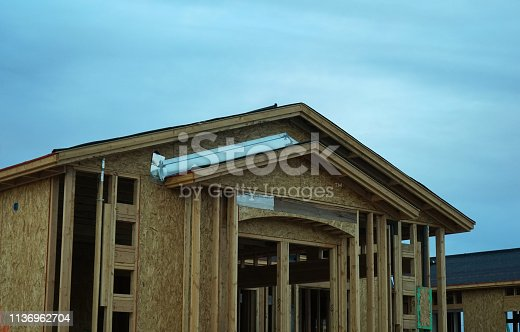 534196421 istock photo wood frame home 1136962704