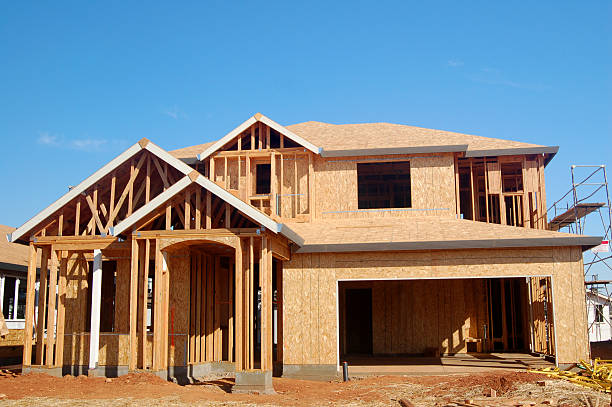 ... Wood frame of a new house under construction stock photo ...