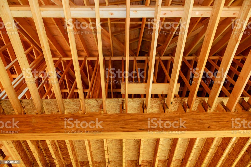 Wood frame residential home under construction. stock photo