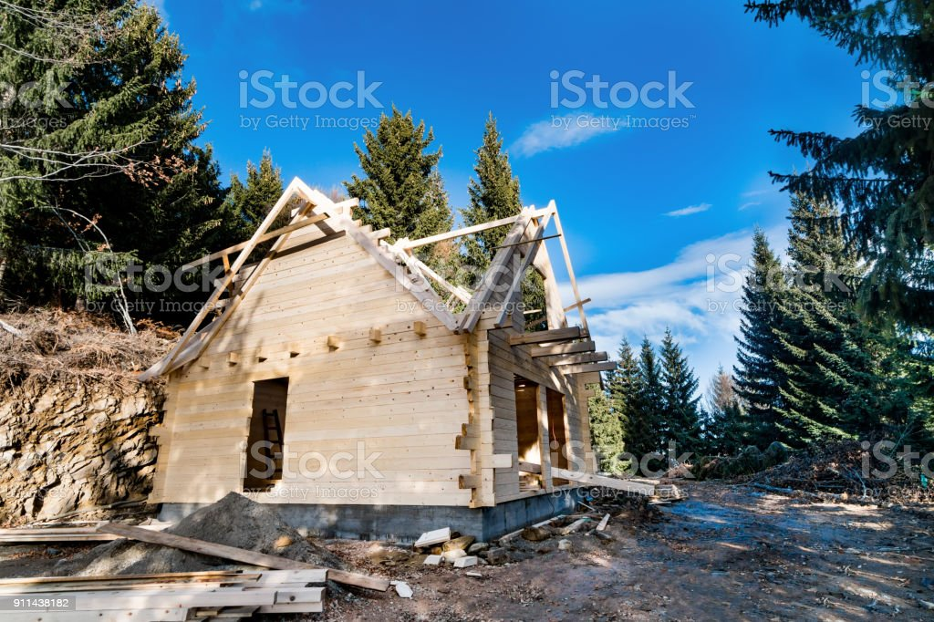 Wood frames construction for a house into mountain pine forest stock photo