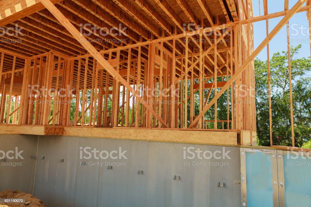 Wood framing on new house under construction stock photo