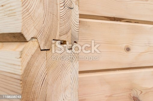 1124475954istockphoto Wood Glued timber close up background. Wooden construction glued laminated timber in the wall of the house. Glued beams. Wooden beams in the groove. 1158038243