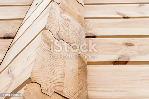 1124475954istockphoto Wood Glued timber close up background. Wooden construction glued laminated timber in the wall of the house. Glued beams. Wooden beams in the groove. 1158038340