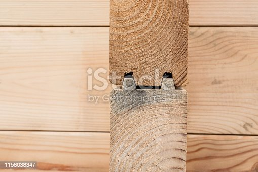 1124475954istockphoto Wood Glued timber close up background. Wooden construction glued laminated timber in the wall of the house. Glued beams. Wooden beams in the groove. 1158038347
