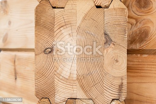 1124475954istockphoto Wood Glued timber close up. Wooden grain timber end background. Glued pine timber beams. Wood for building a house. Building materials made of wood. Glued beams. Wooden beams in the groove. 1158038295