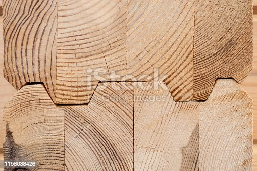 1124475954istockphoto Wood Glued timber close up. Wooden grain timber end background. Glued pine timber beams. Wood for building a house. Building materials made of wood. Glued beams. Wooden beams in the groove. 1158038426