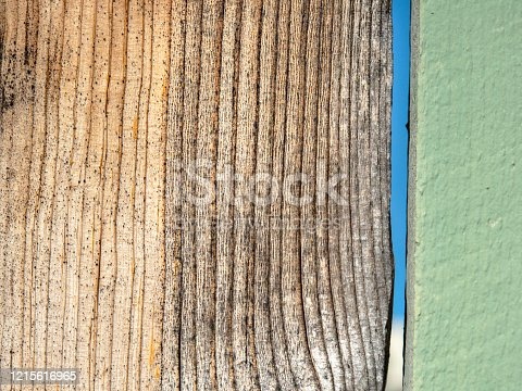 Wooden fence showing natural wood grain and green paint detail – perfect as a background image.