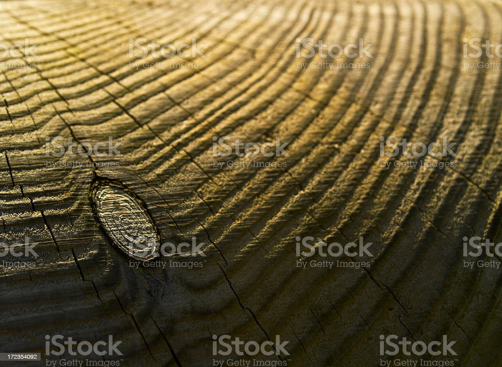 Wood grain and knot atop post royalty-free stock photo