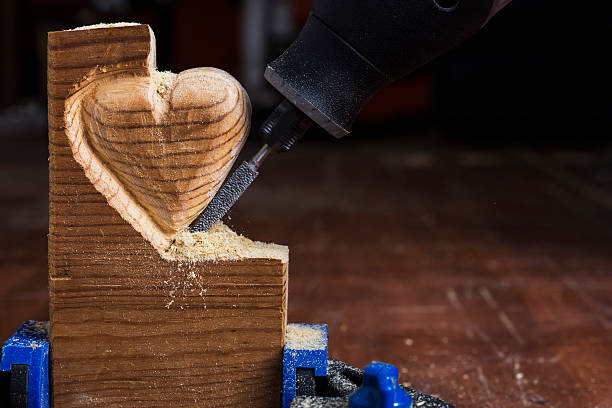wood  heart - dremel wood stock photos and pictures