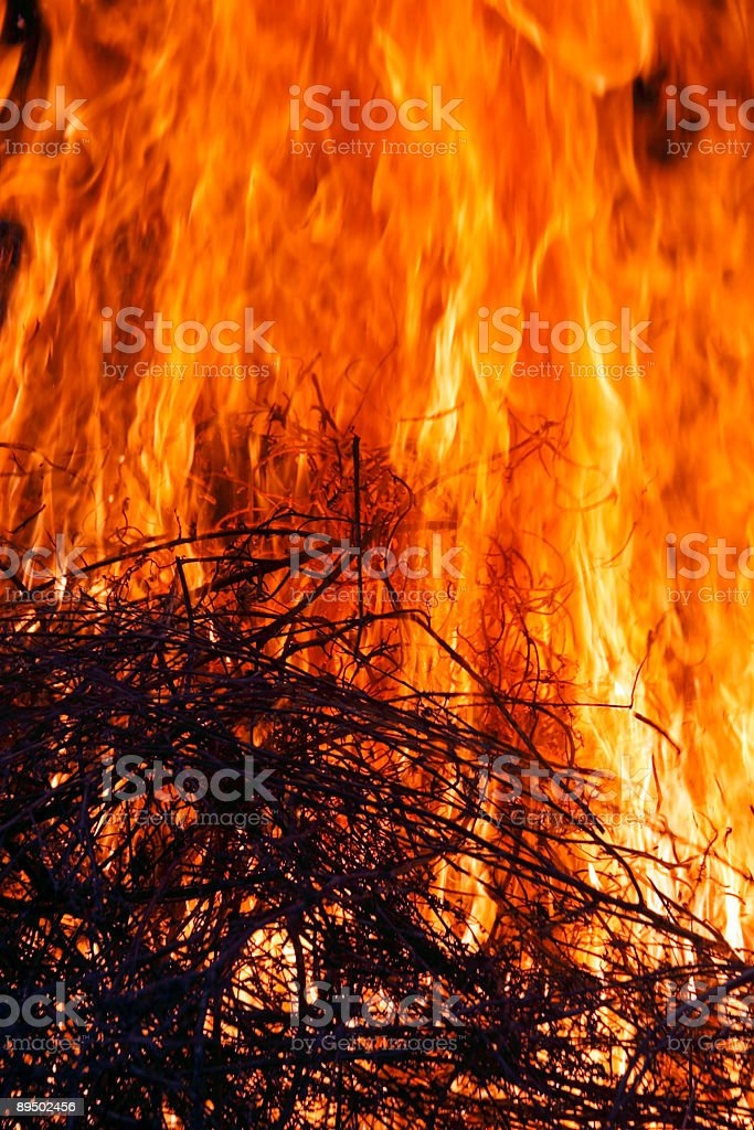 Wood in the flames of a big fire royalty-free stock photo