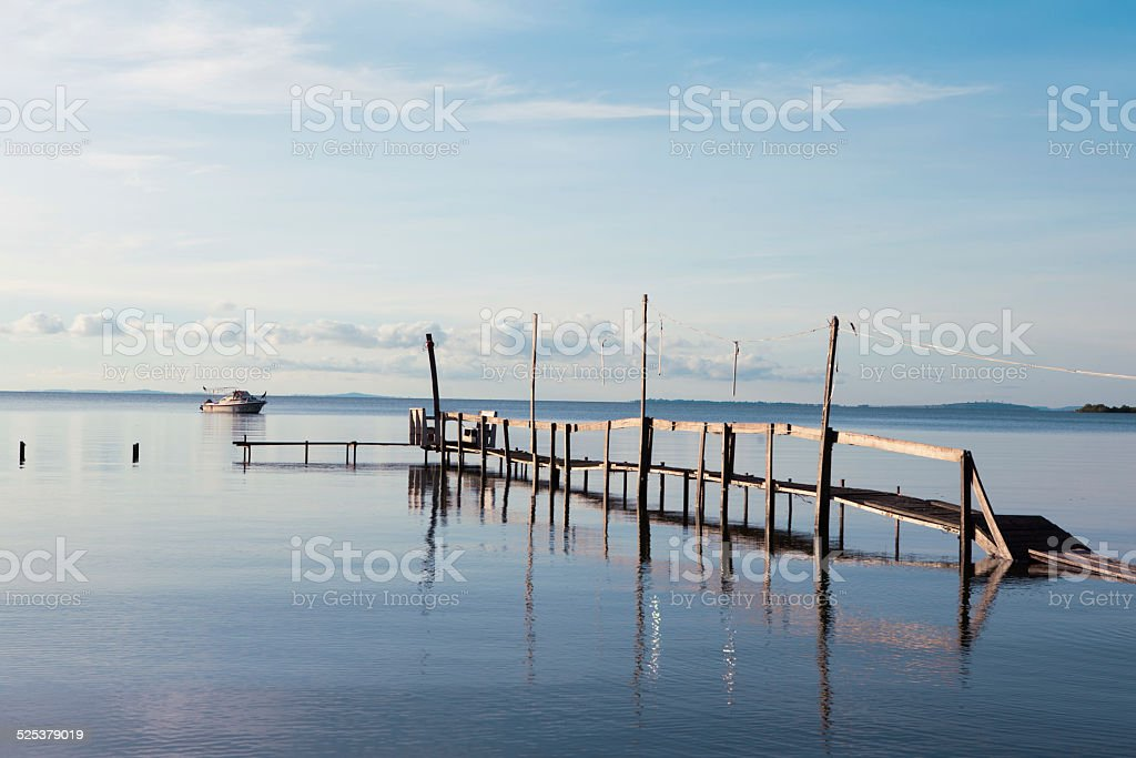 wood jetty in African lake stock photo