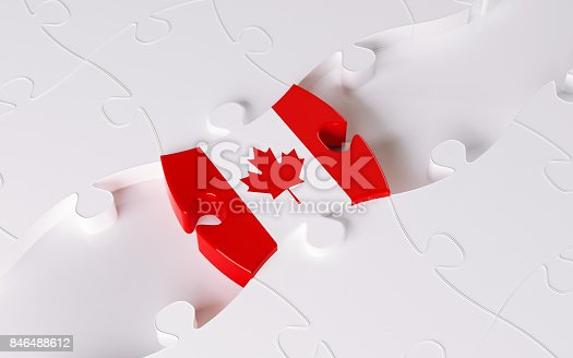 istock Wood Jigsaw Puzzle Textured with Canadian Flag Forming A Bridge; Bridging Concept 846488612