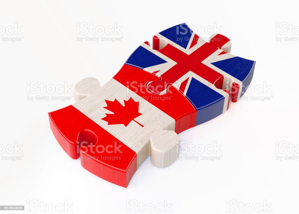 Wood Jigsaw Puzzles Textured with UK and Canada Flags ; Teamwork Concept stock photo