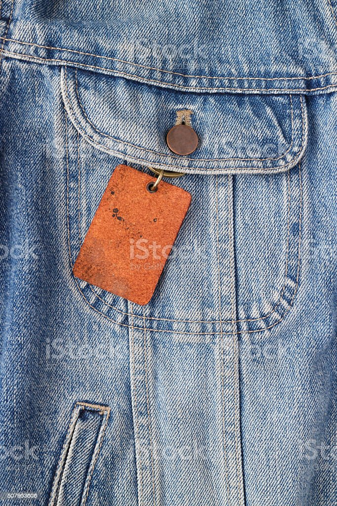 Wood label, Price tag on jeans jacket background photo