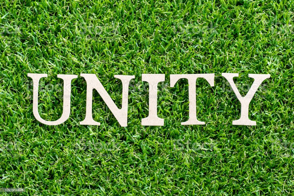 Wood Letter In Word Unity On Artificial Green Grass