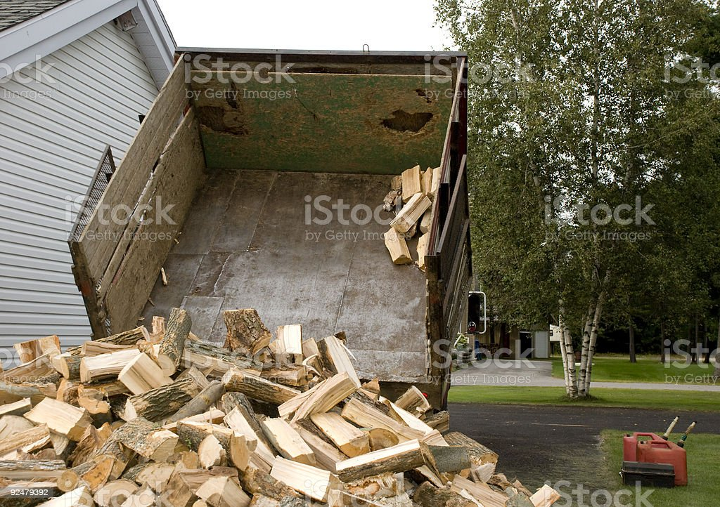 wood log dumping burning logs firewood royalty-free stock photo