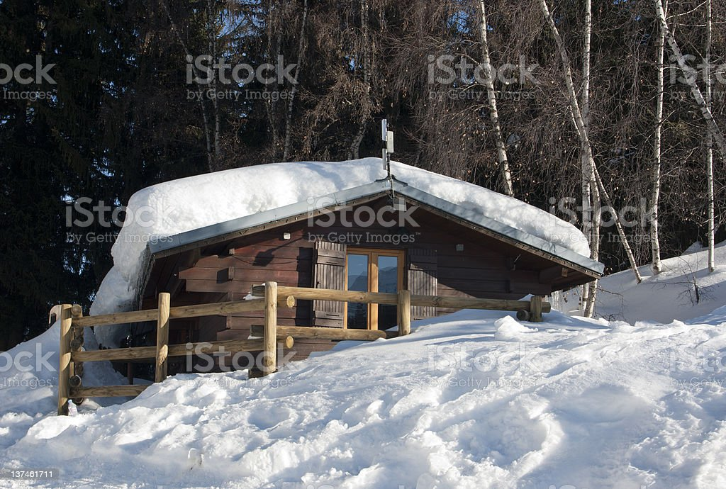 Wood Logde emerging from the snow stock photo