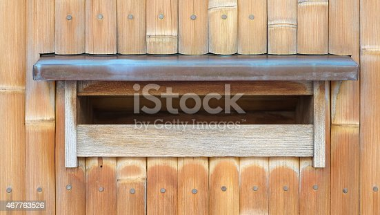 istock Wood mail box on traditional bamboo wall background 467763526