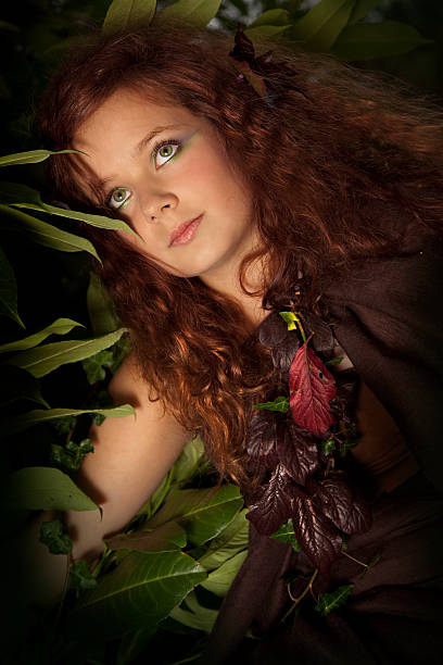 wood nymph - woman green eyes red hair stock photos and pictures