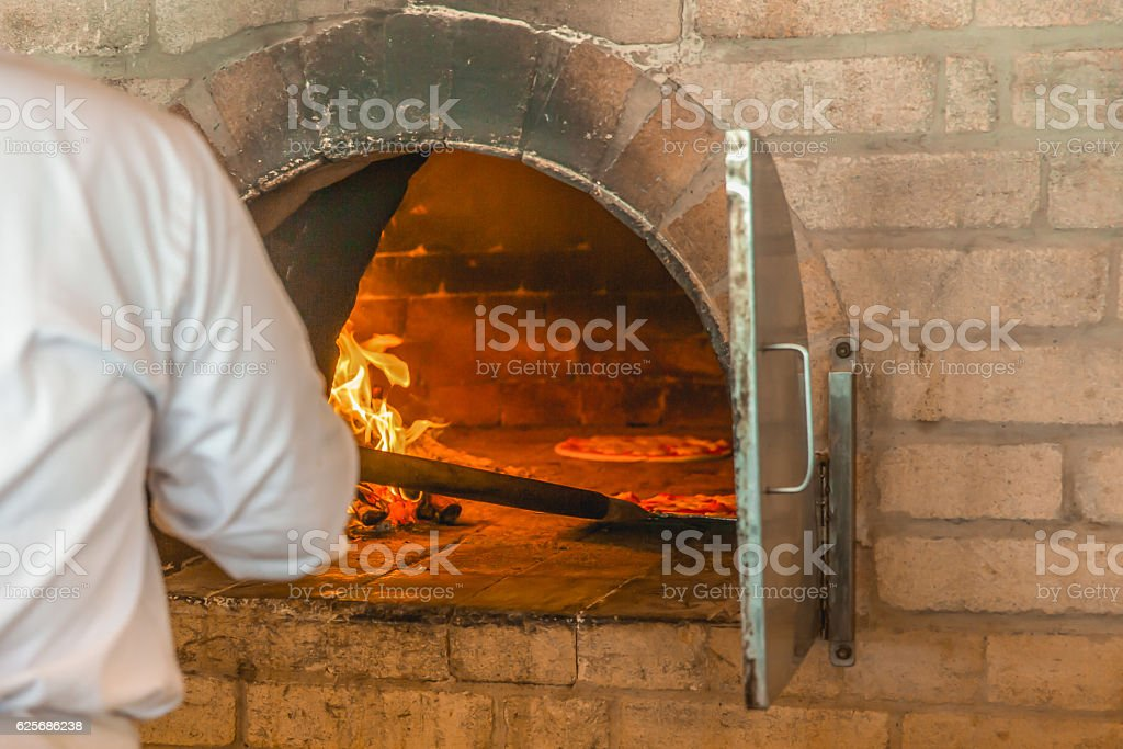 Wood oven pizza stock photo
