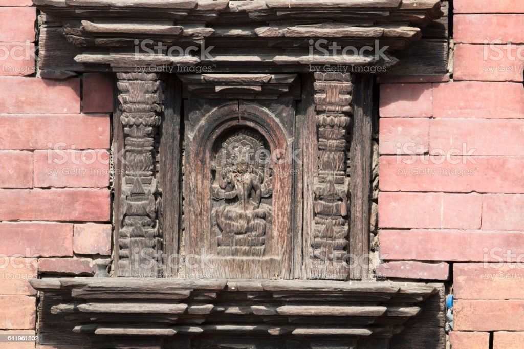 Wood panel with carving of Hindu god, Bhaktapur, Kathmandu stock photo