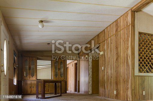 Wood paneled walls in an abandoned double wide home in the deep south